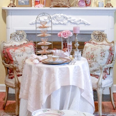French inspired tea party table setting with pink and gold Versace plates