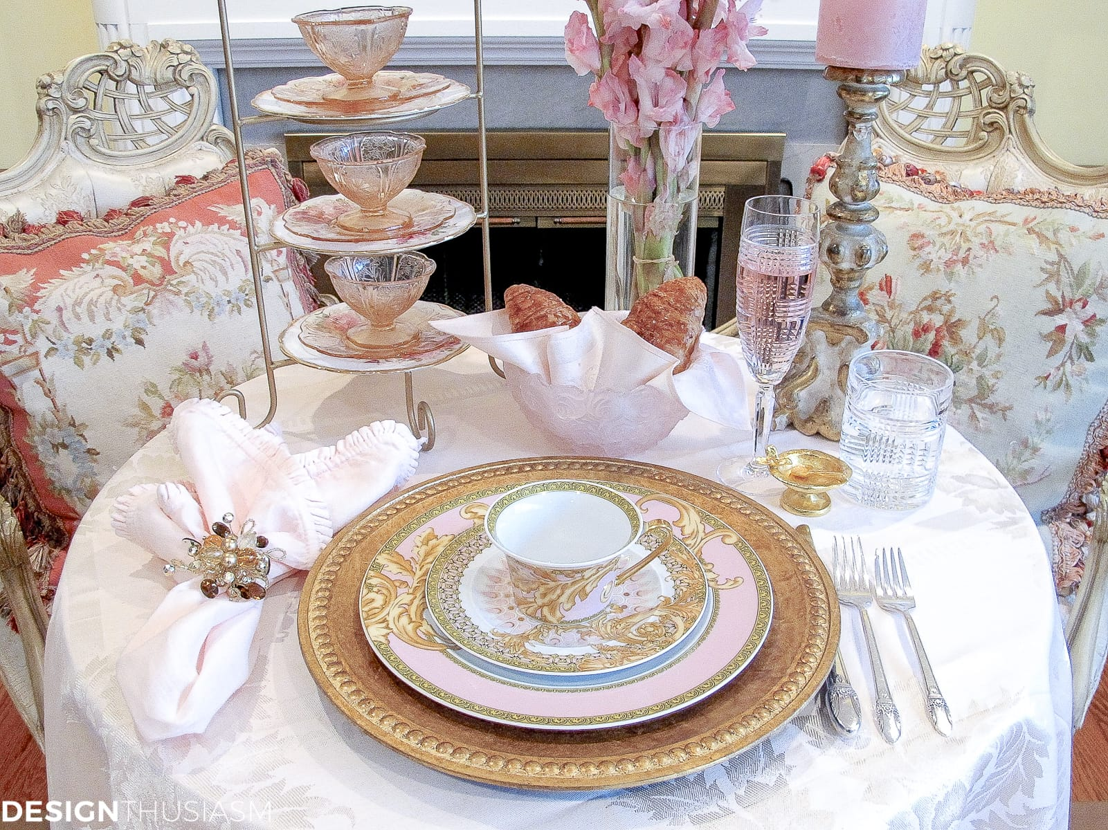 Tea party table setting with pink and gold Versace plates