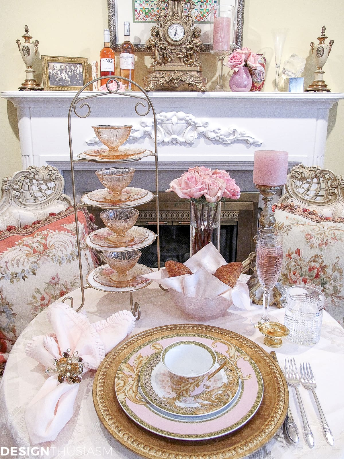 Tea party table setting with pink and gold Versace plates and aubusson pillows