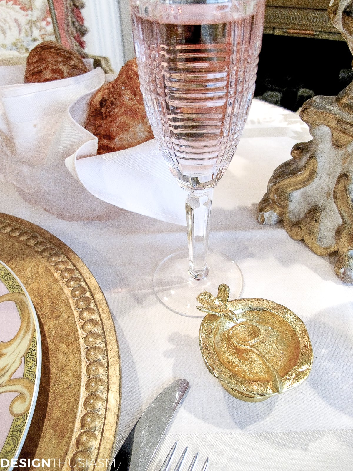 Tea party table setting with champagne flutes and gold salt cellar