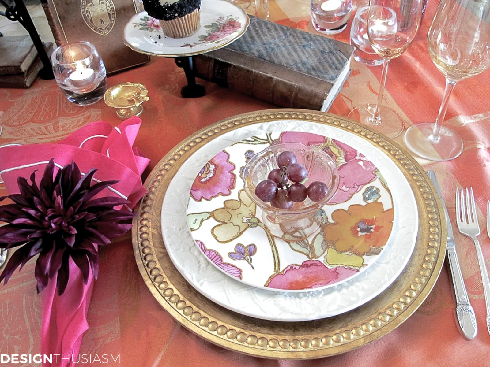 floral plates on a book club table setting with vintage books