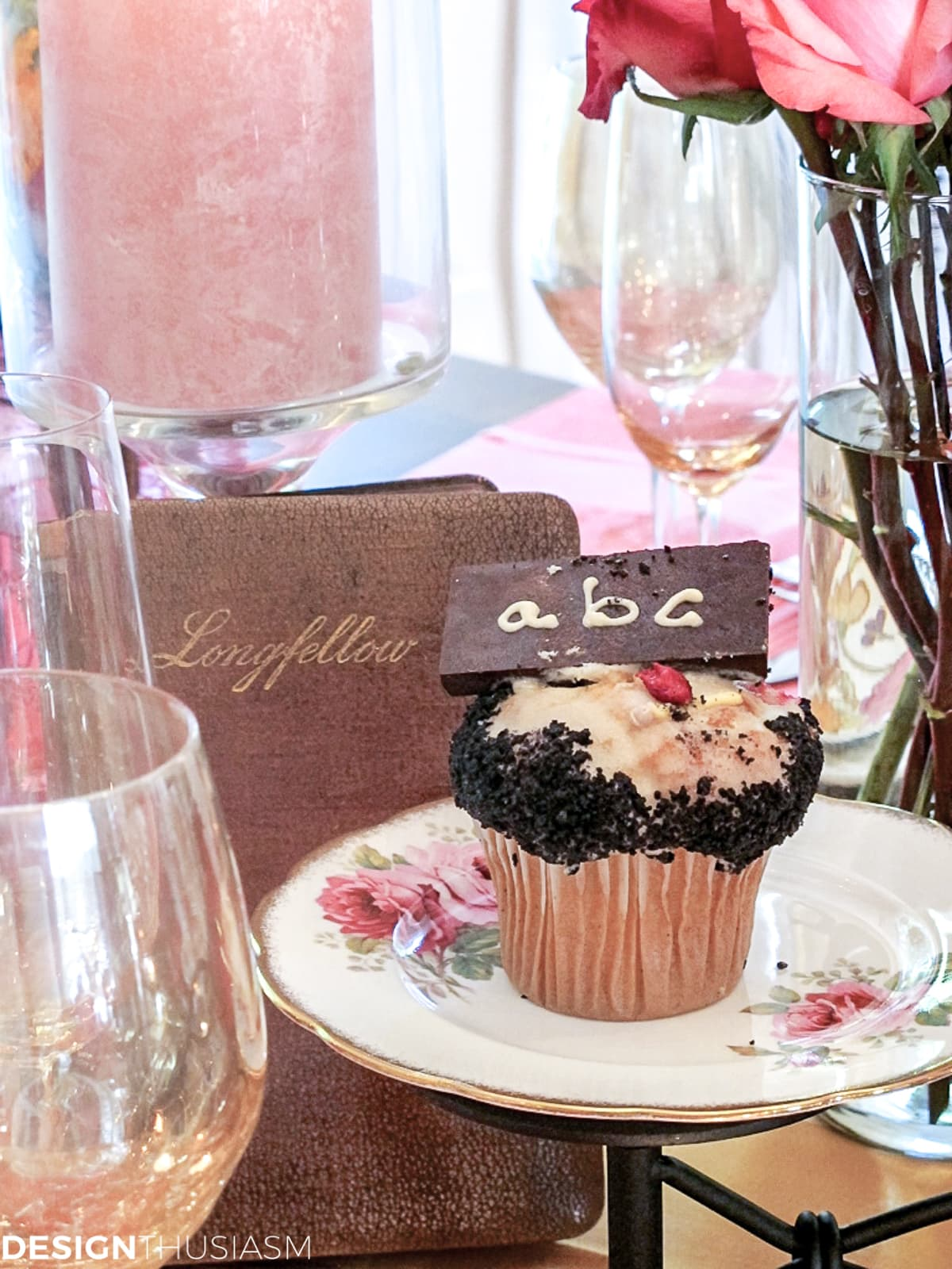 book club table setting with vintage books and alphabet cupcakes