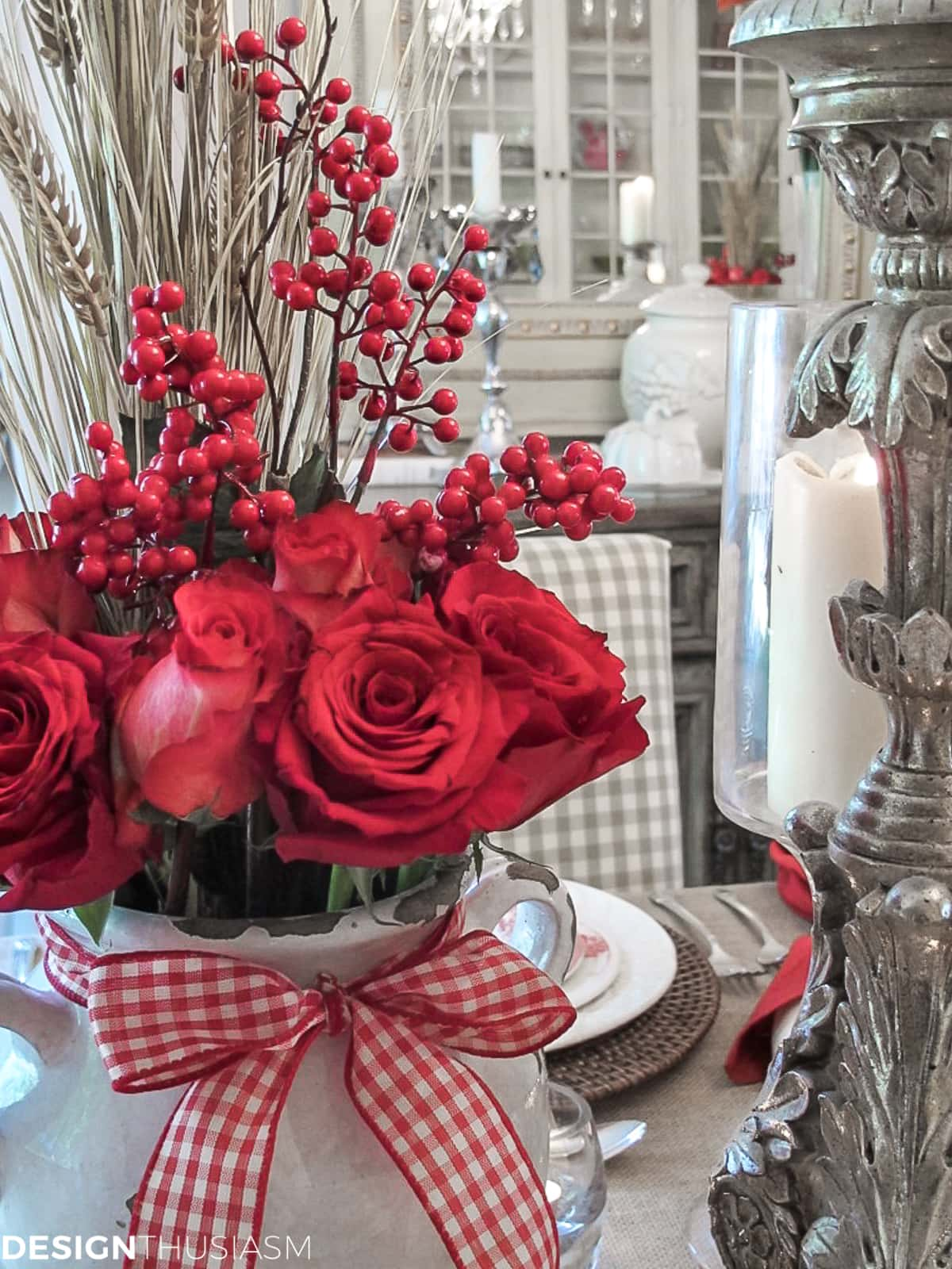 red floral in a rustic table setting