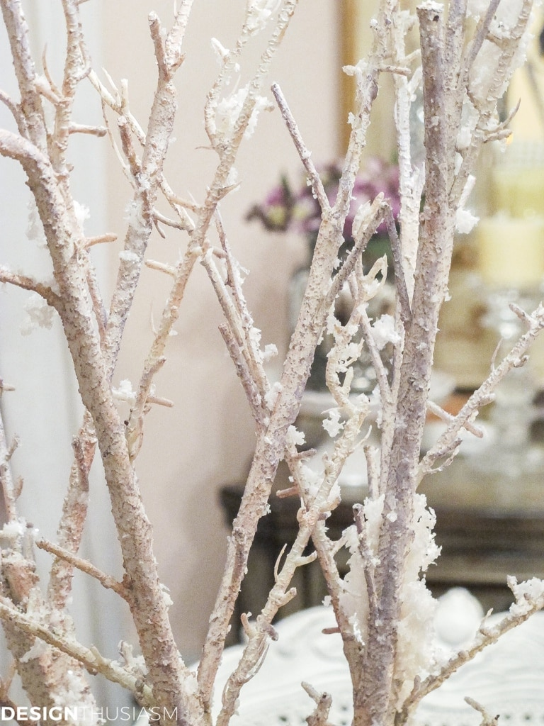 faux snow covered branches in a cozy home