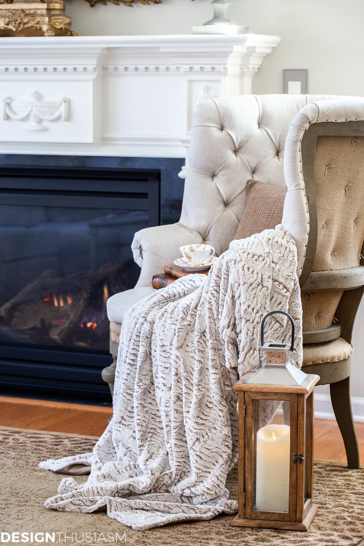 faux fur throw blanket with tweed pillow in a cozy winter living room