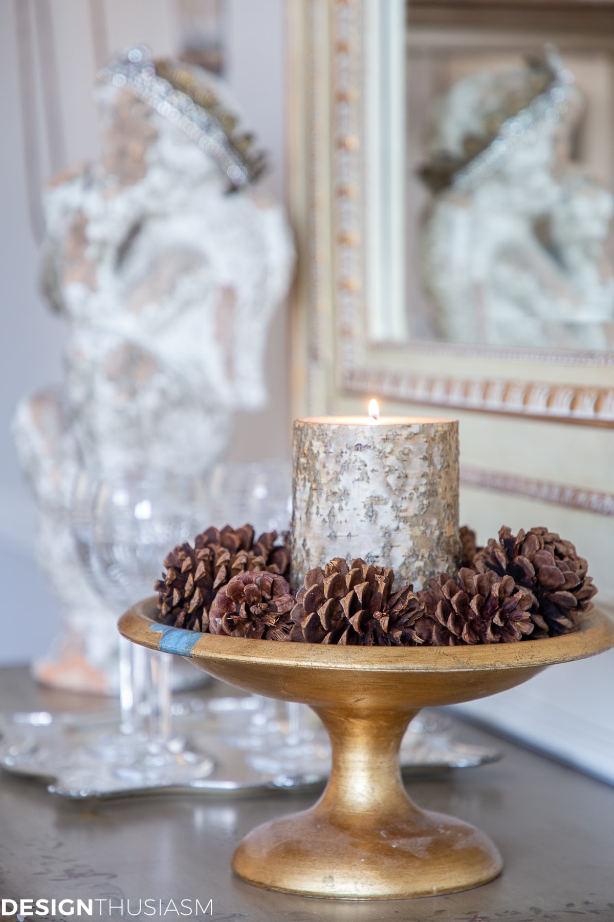 winter home accessories with bark candle and pine cones