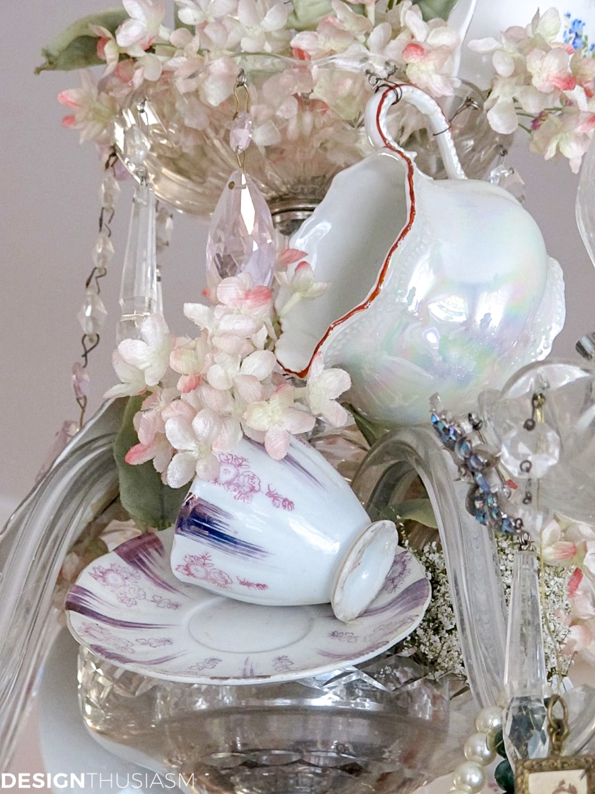 vintage teacups and saucers on a chandelier