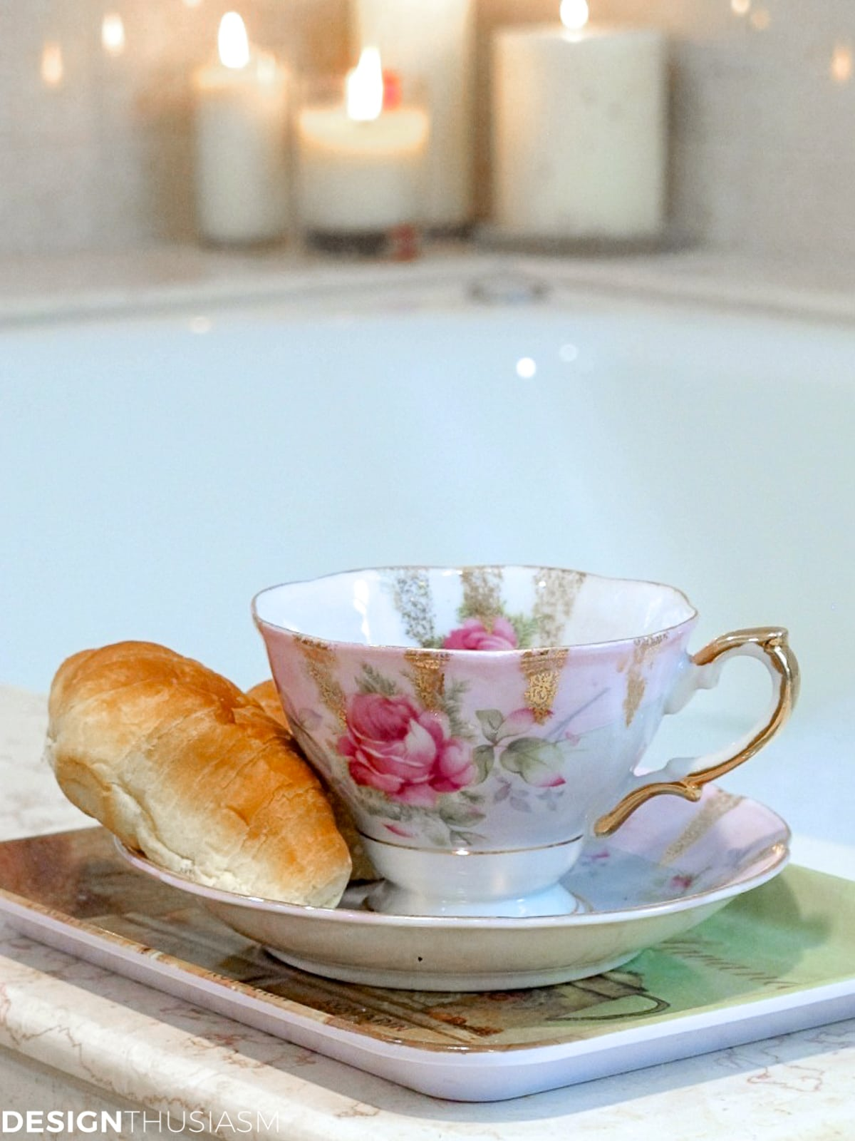 vintage tea cup and saucer on a bathtub surround
