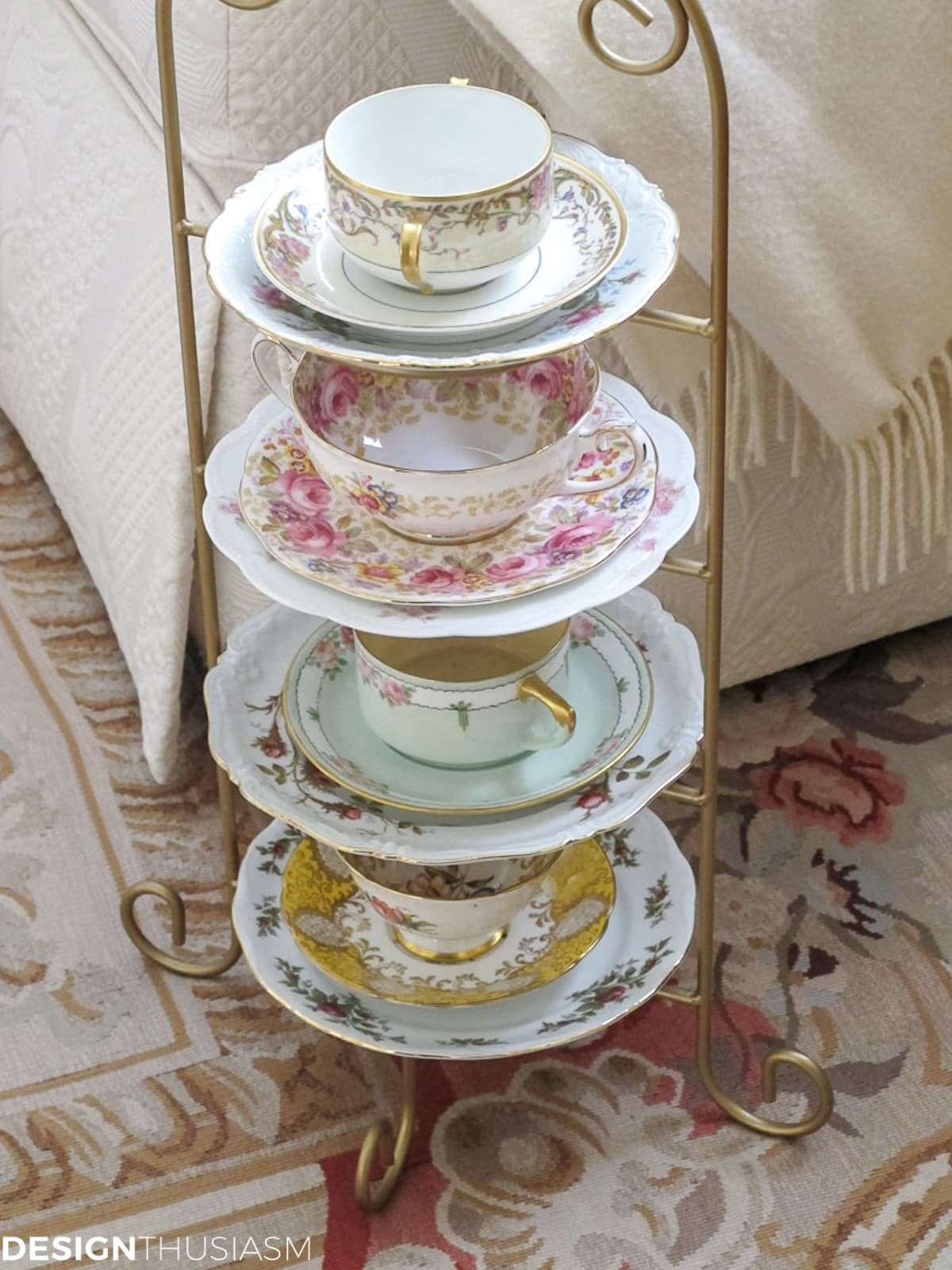 vintage teacups and saucers displayed on a wire rack
