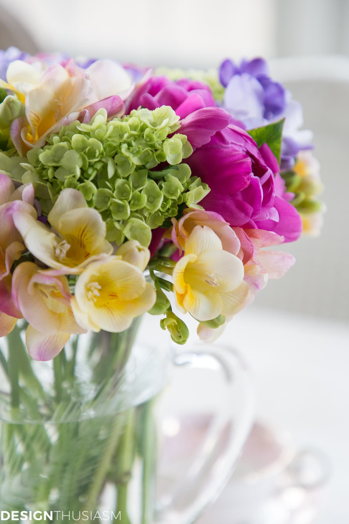 floral centerpiece with a tea cup in the background