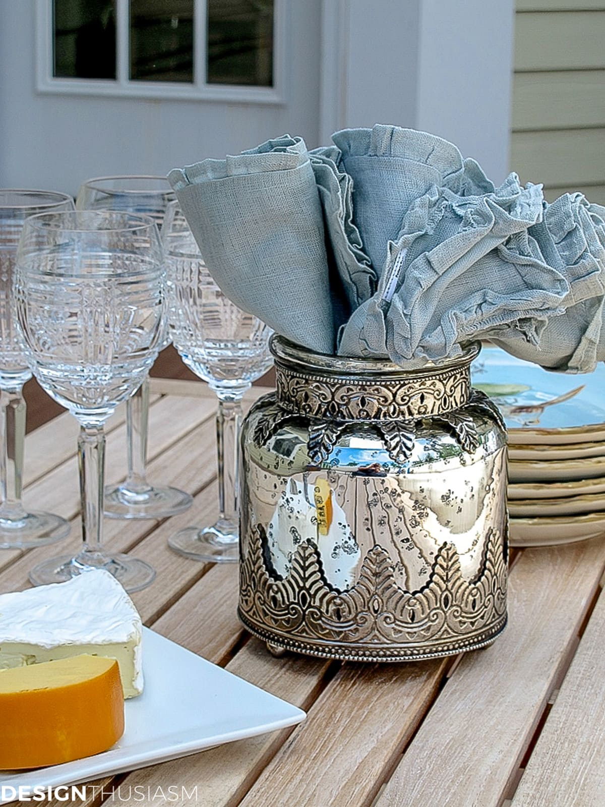 napkins in a vase on the patio