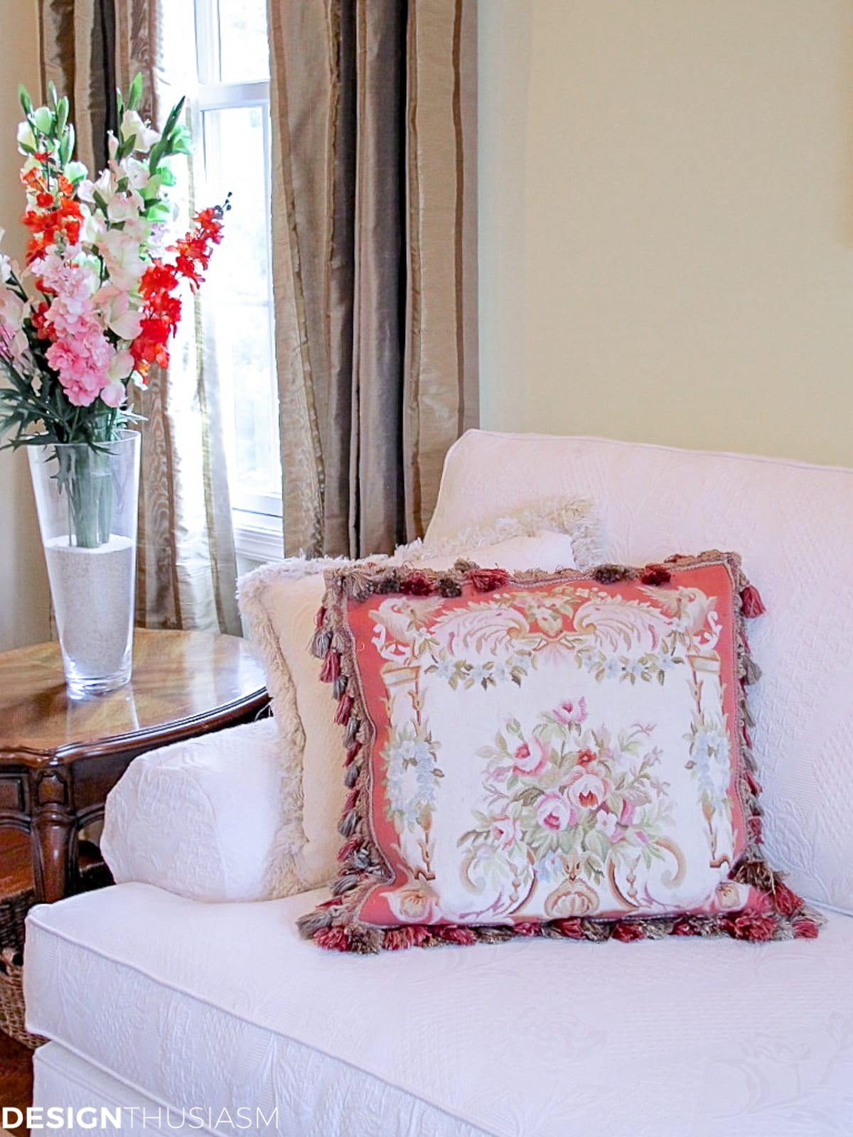 needlepoint pillow in the living room