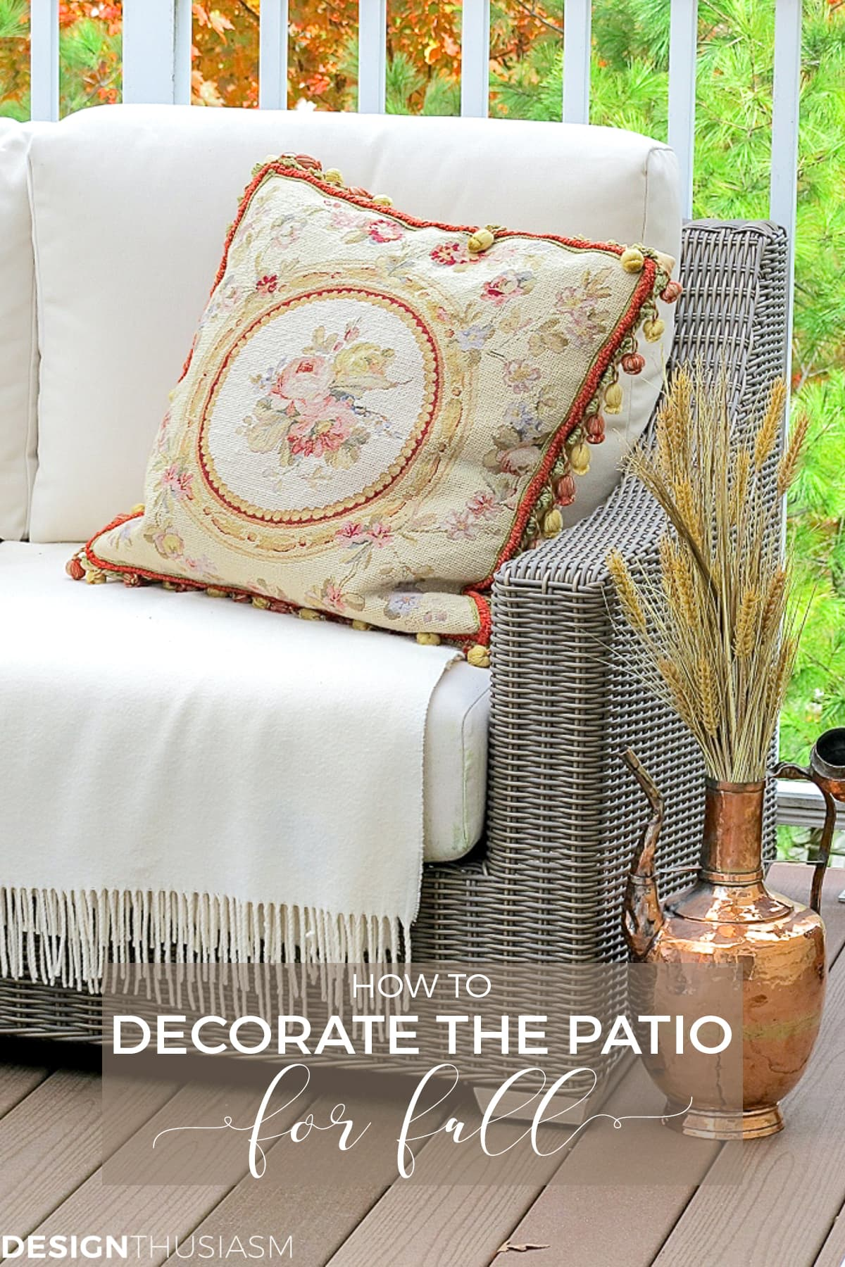 fall patio with copper urn and needlepoint pillow