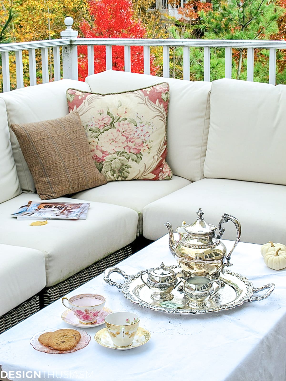 tweed and floral pillows on a fall patio