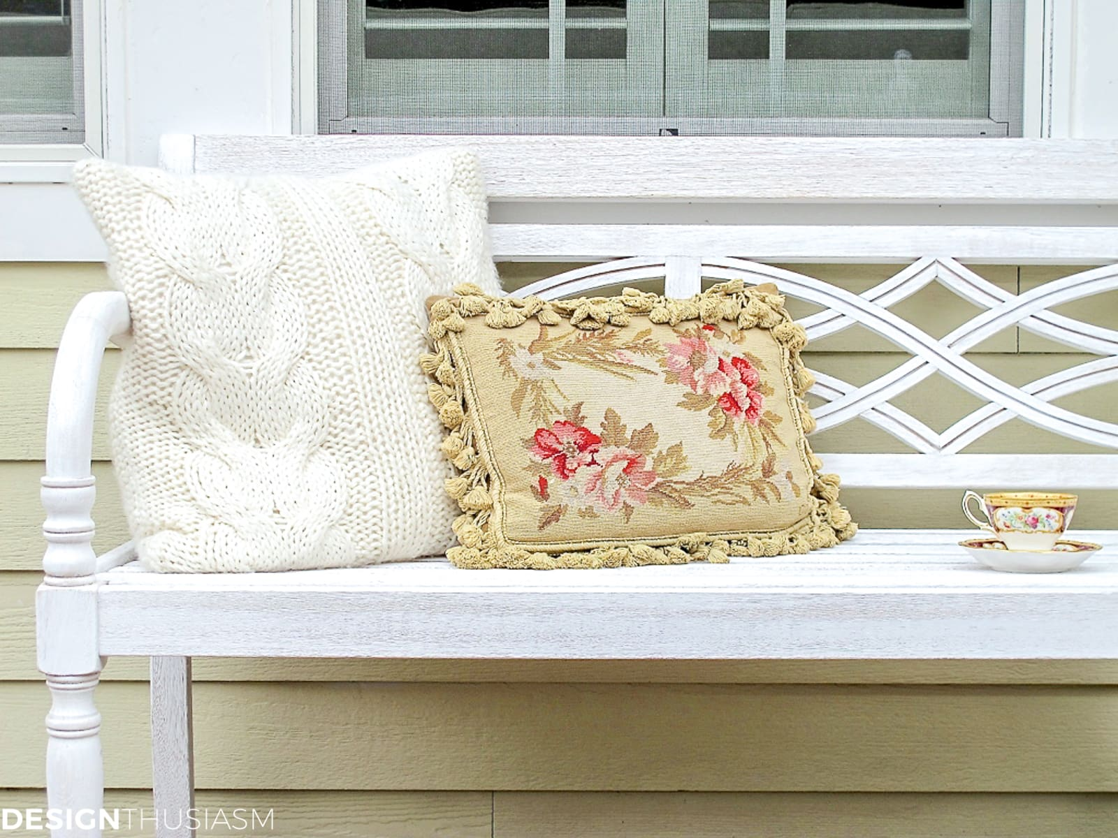 outdoor fall decorations with a whitewashed bench and fall pillows