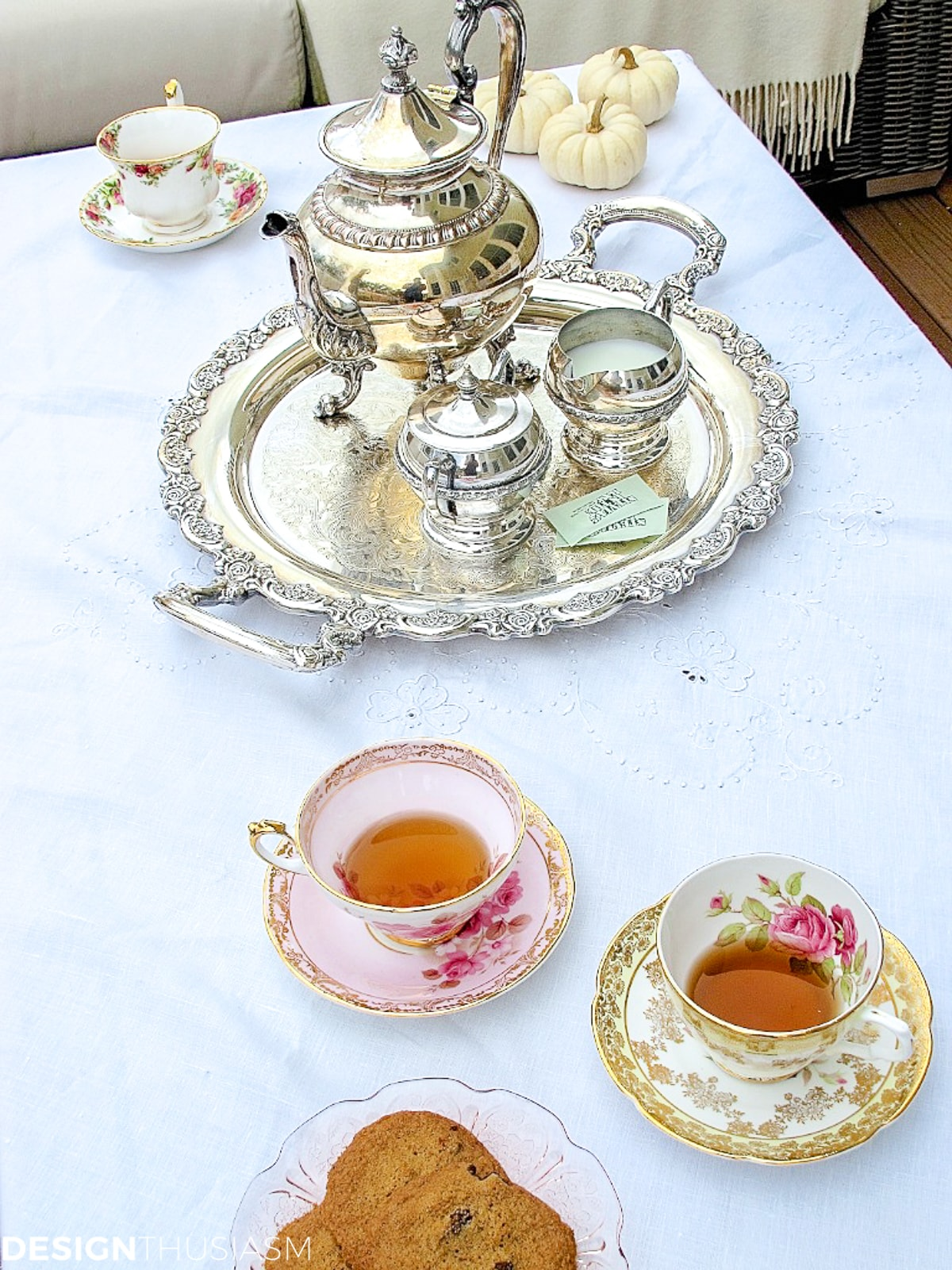 tea set and teacups on a fall patio
