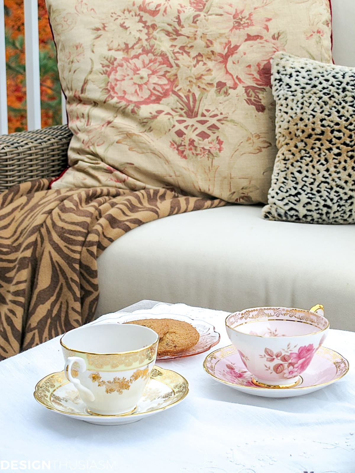 fall patio with fall pillows and teacups