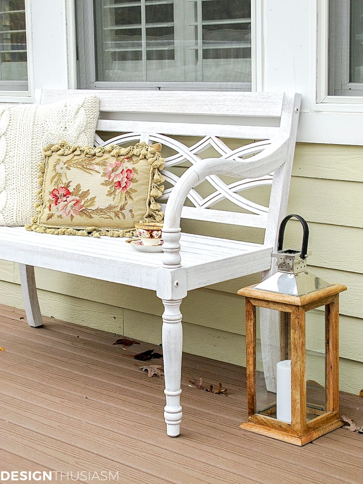 fall patio with a whitewashed bench and rustic lantern