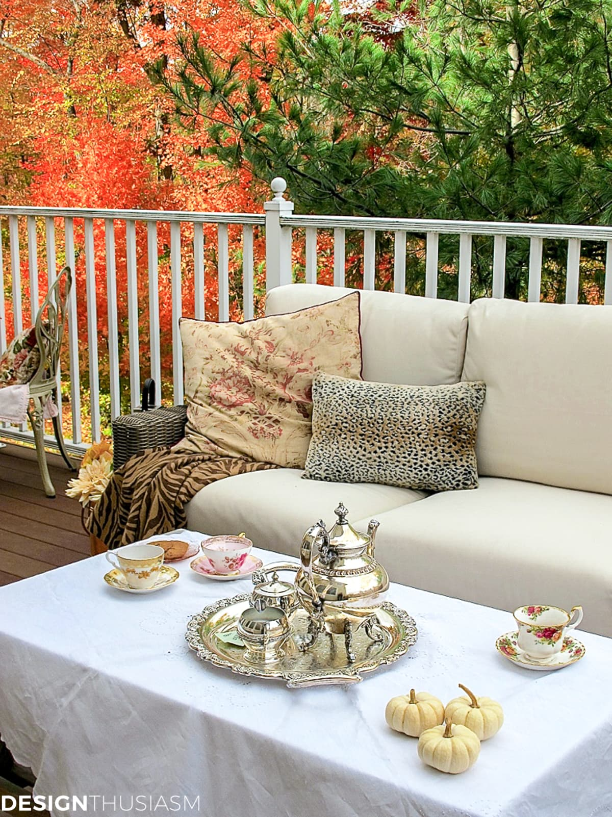 fall pillows and throw on a fall patio