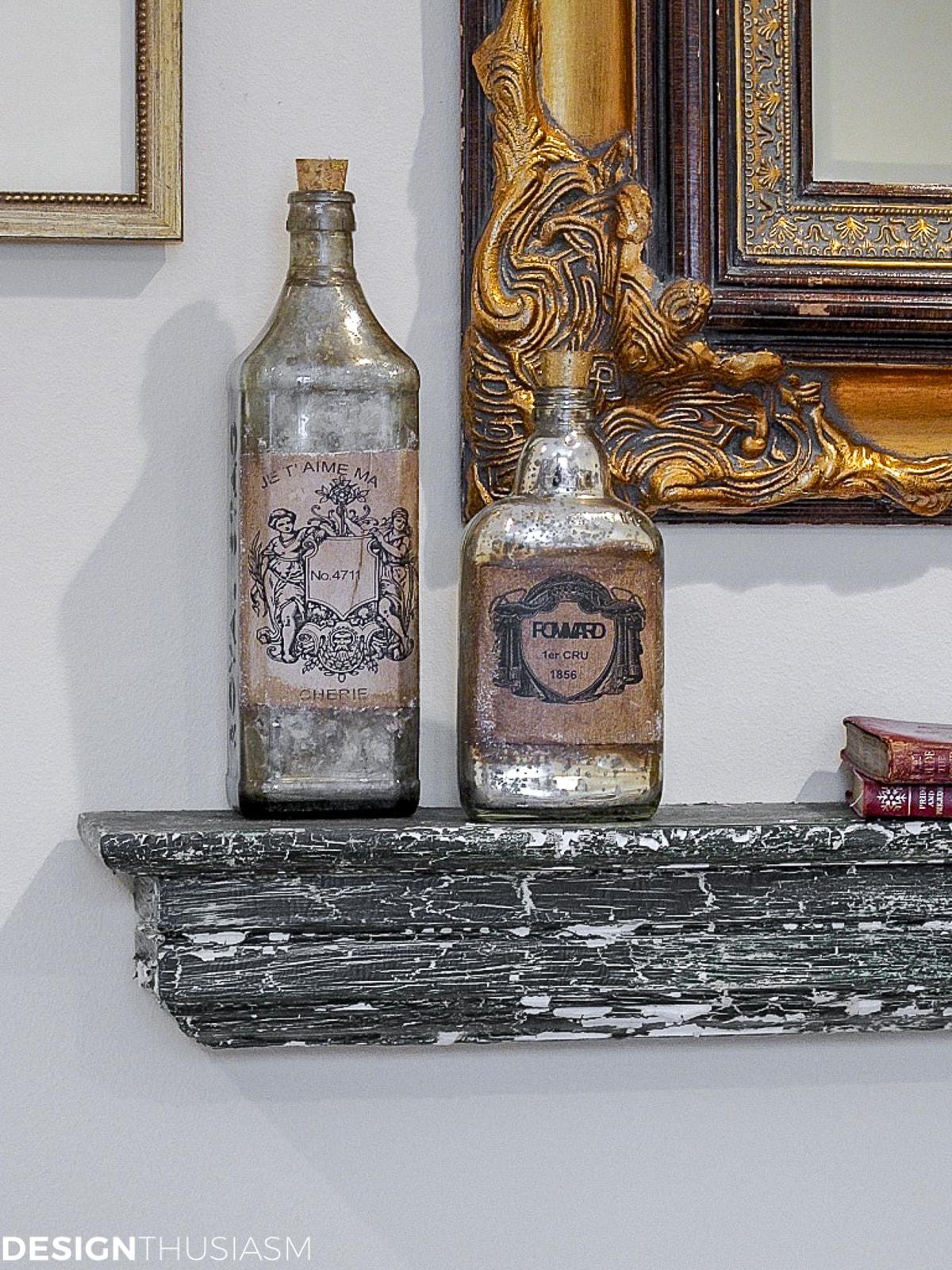chippy shelf with French bottles