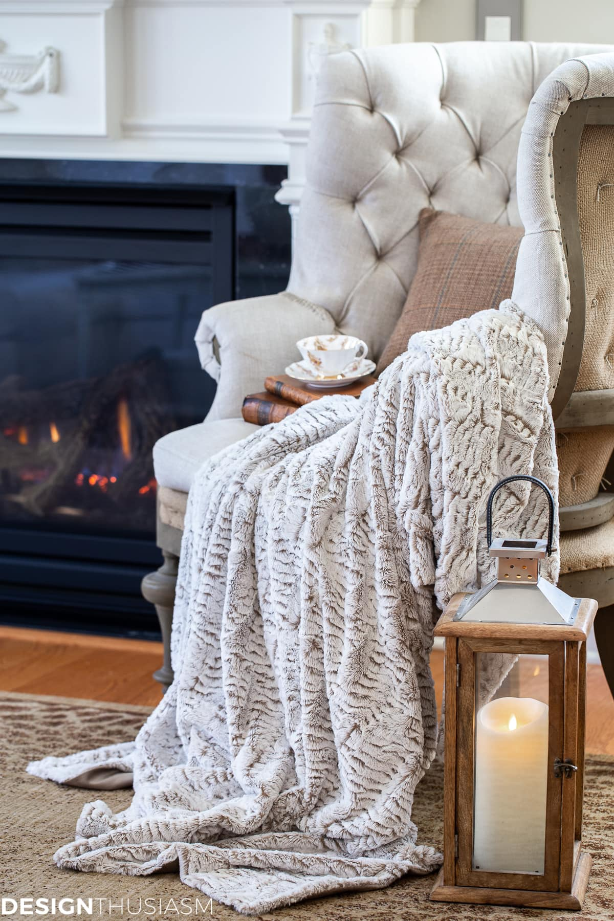 tufted chair with faux fur throw and tweed pillow