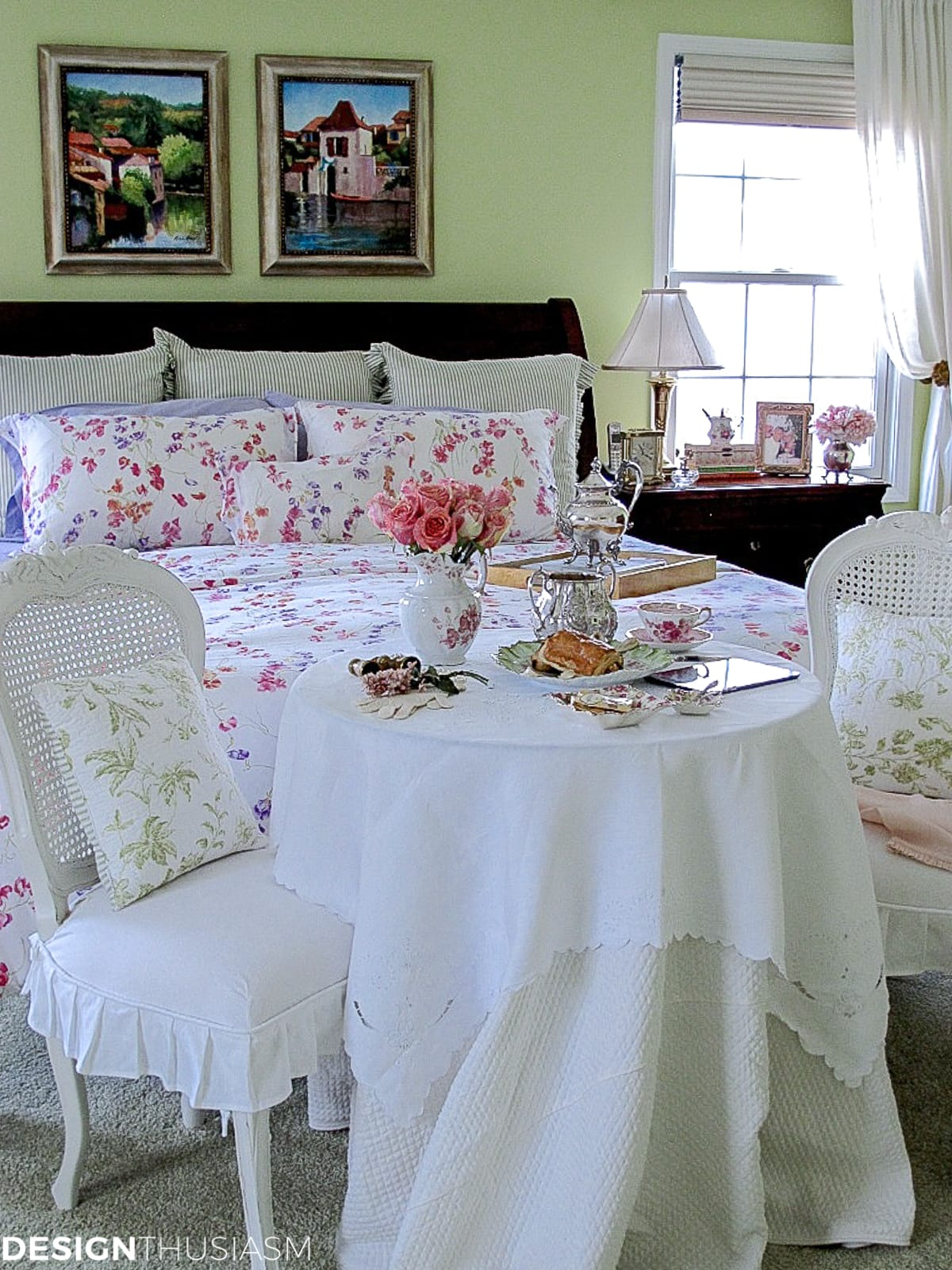 master bedroom decor with a french style bistro table at the foot of the bed