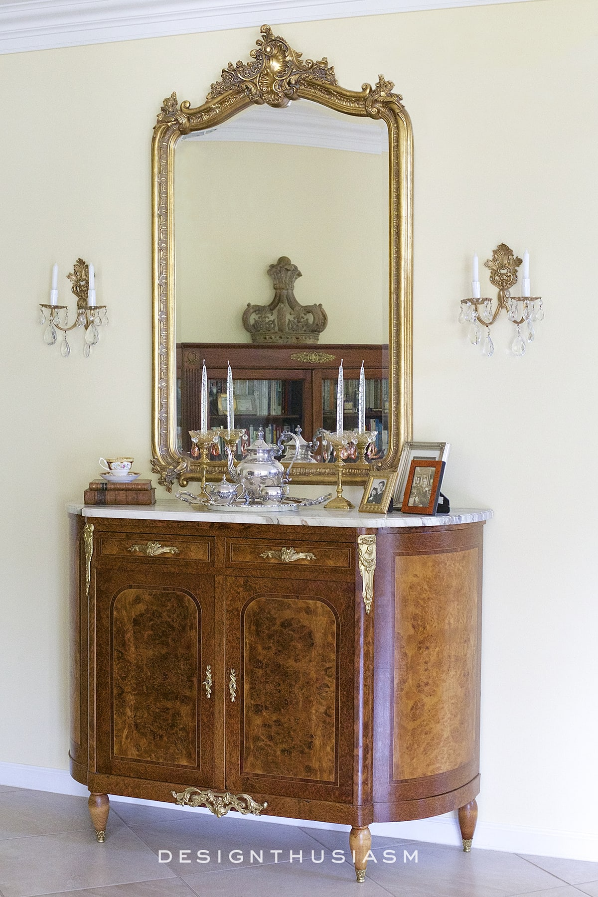 gold mirrors in the entryway create a elegant french country feel