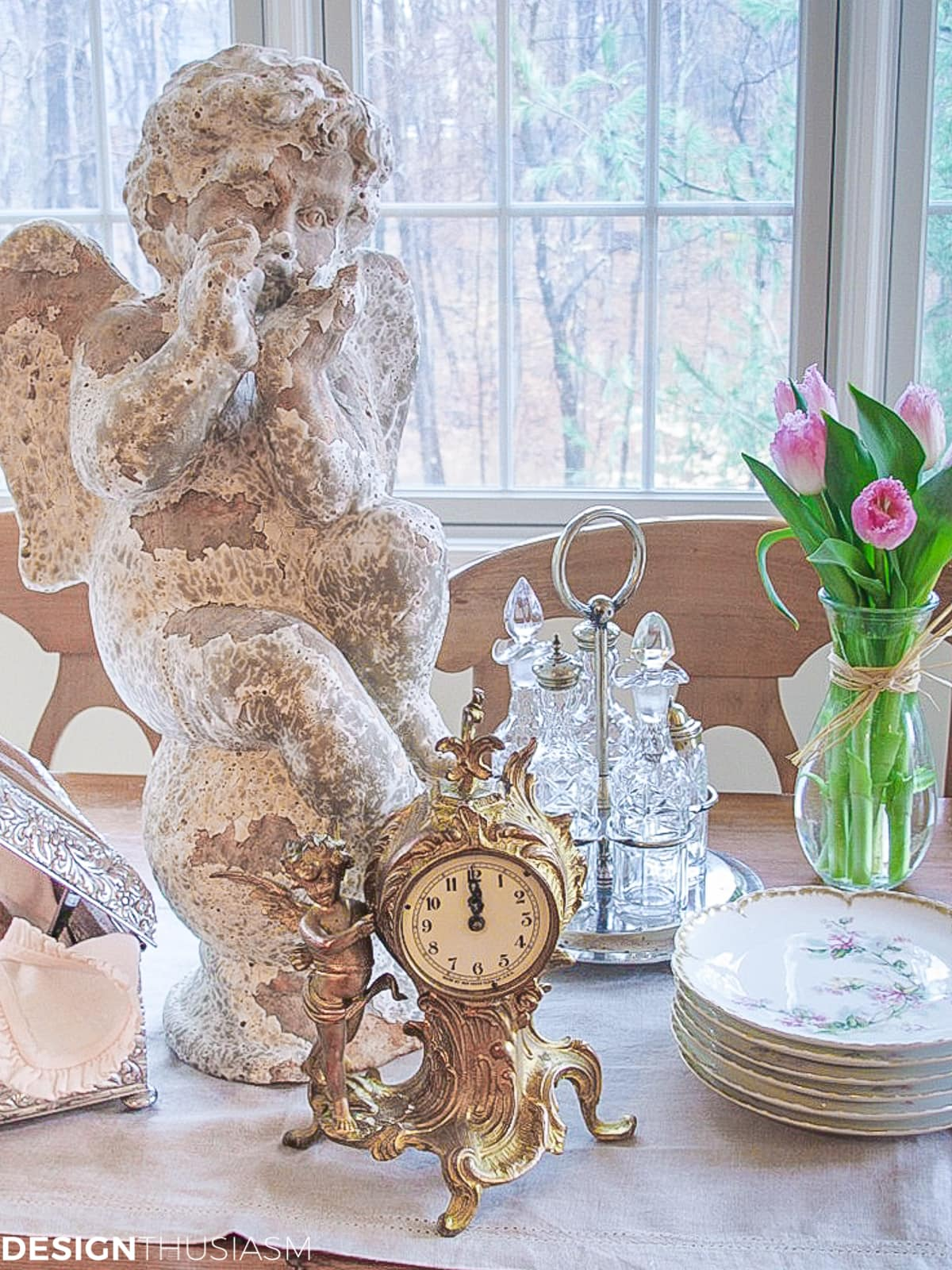 chippy vintage garden statue and flea market finds in the kitchen