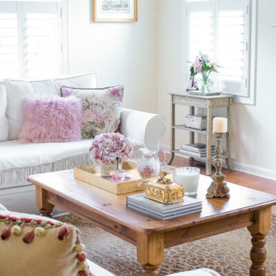 french country living room with a small accent table