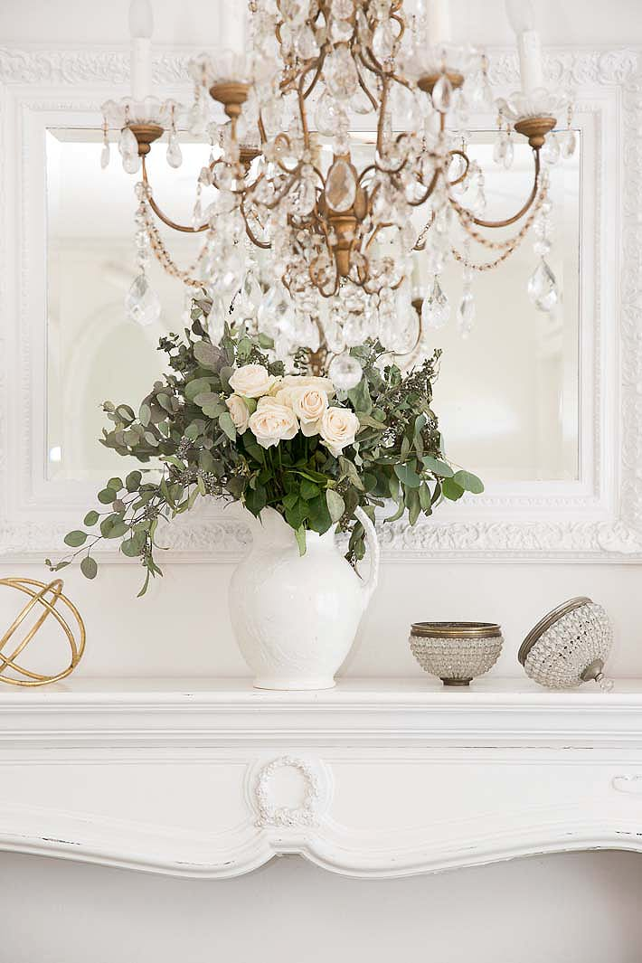 white roses on a mantel
