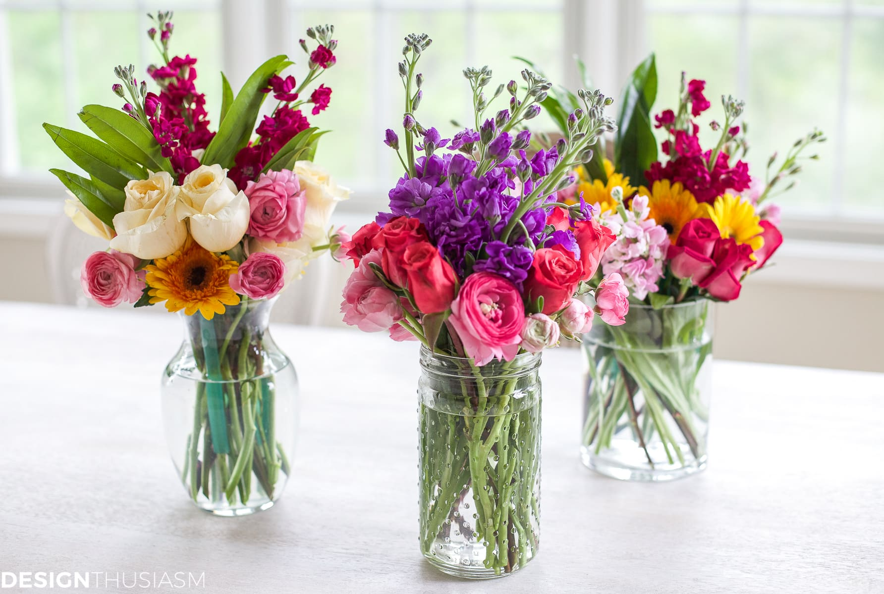 Arranging spring flowers into small displays - designthusiasm.com