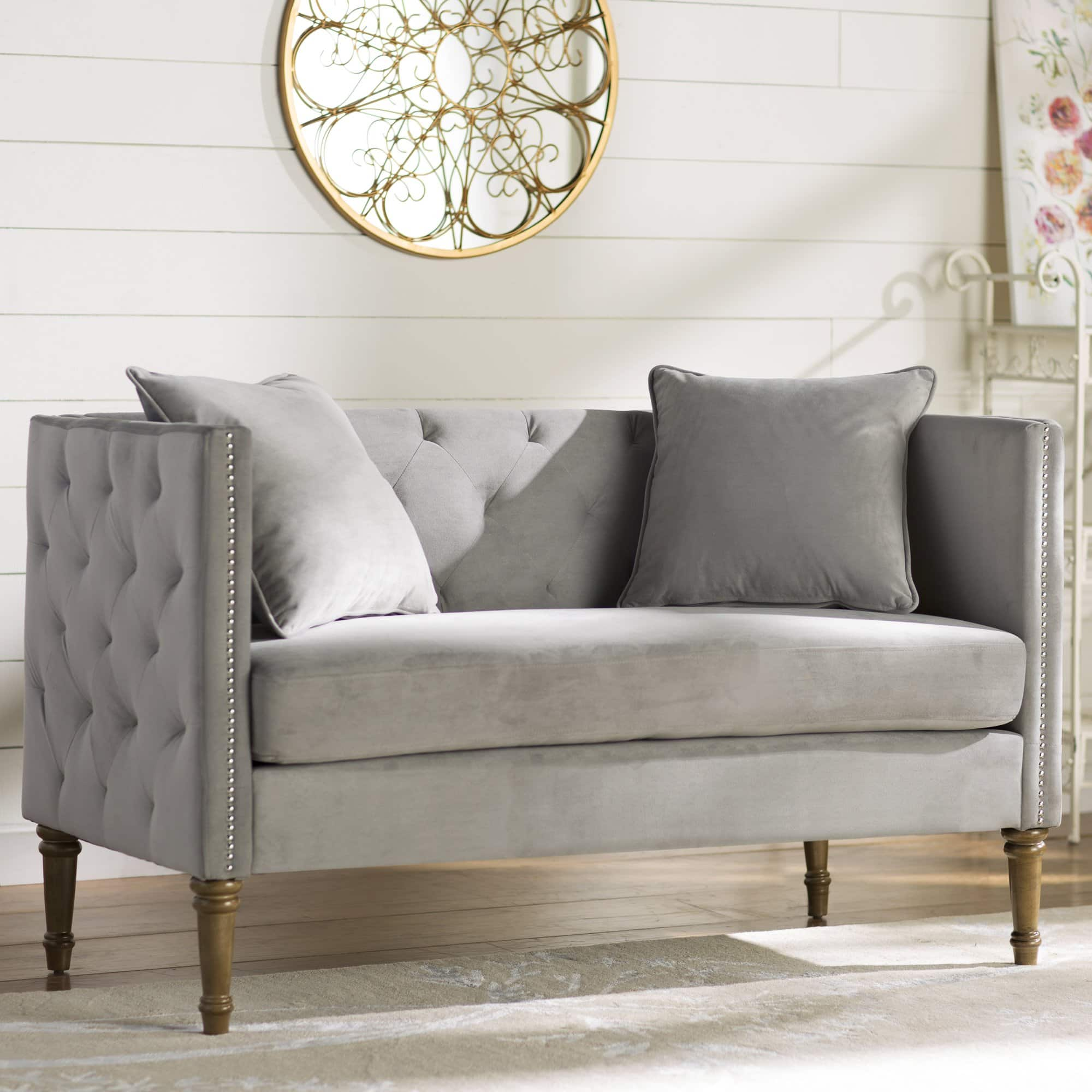 Grey tufted French settee