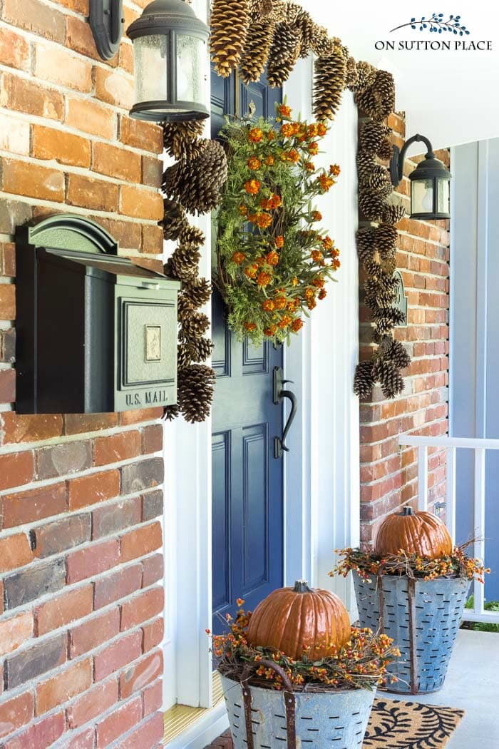 fall front porch pinecone garland
