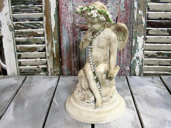 Rustic cherub statue