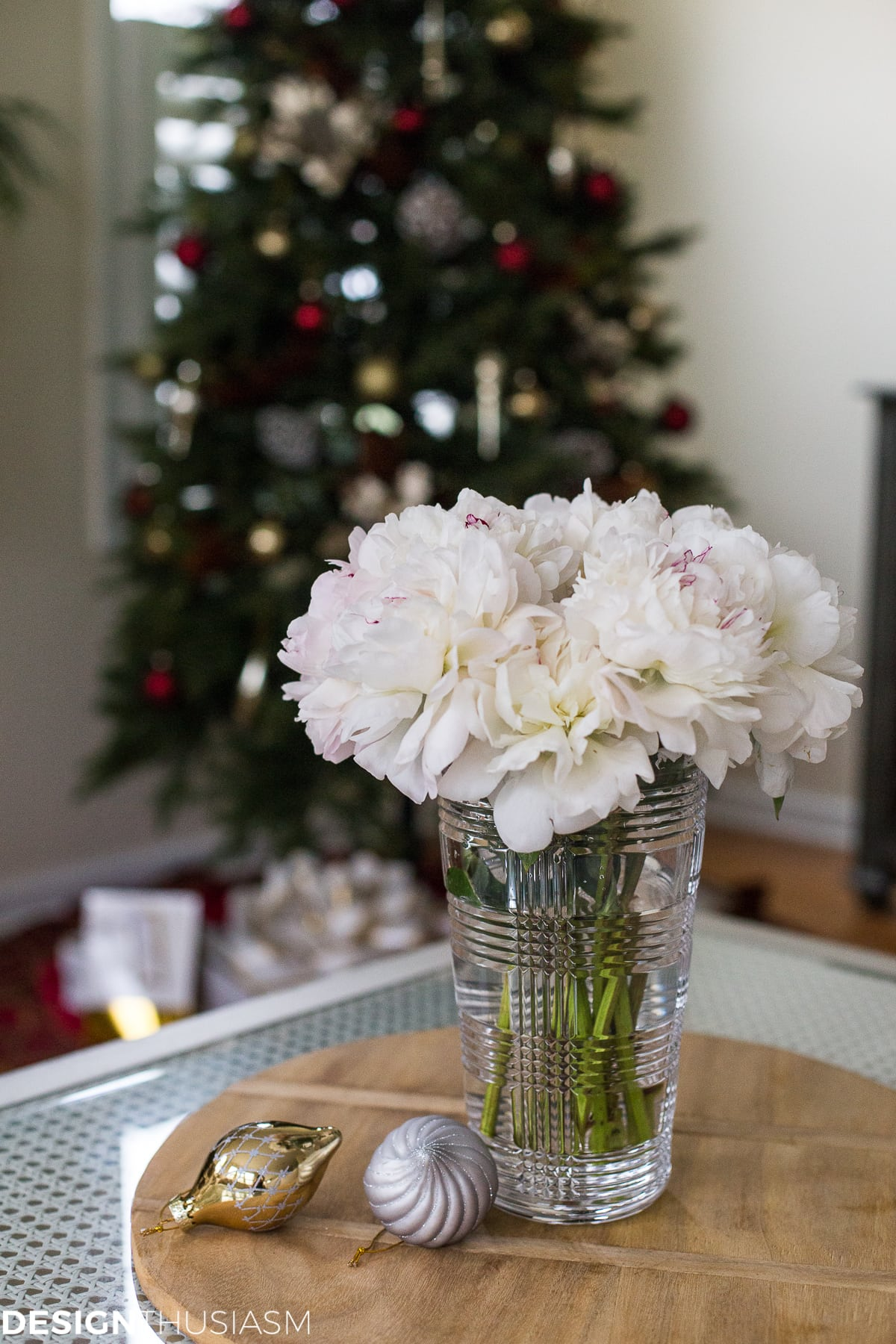 Adding Cheer to the Family Room with a Slim Christmas Tree - designthusiasm.com