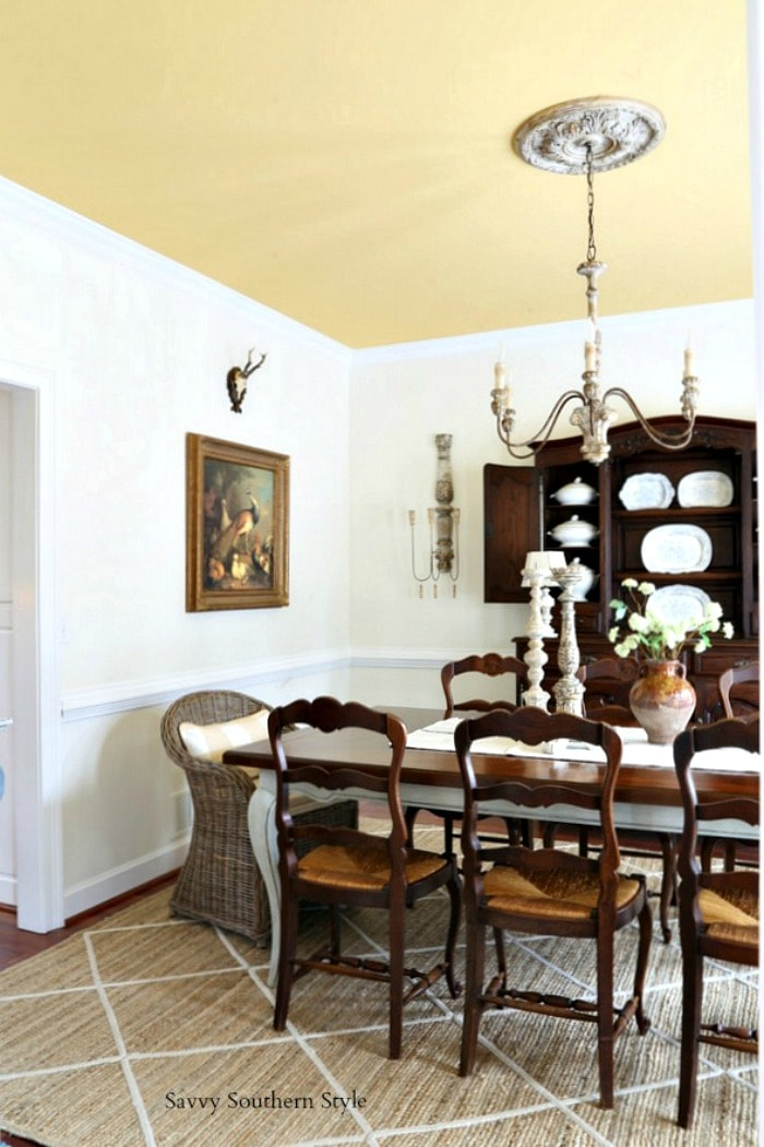 Swapping chairs in a French country dining room