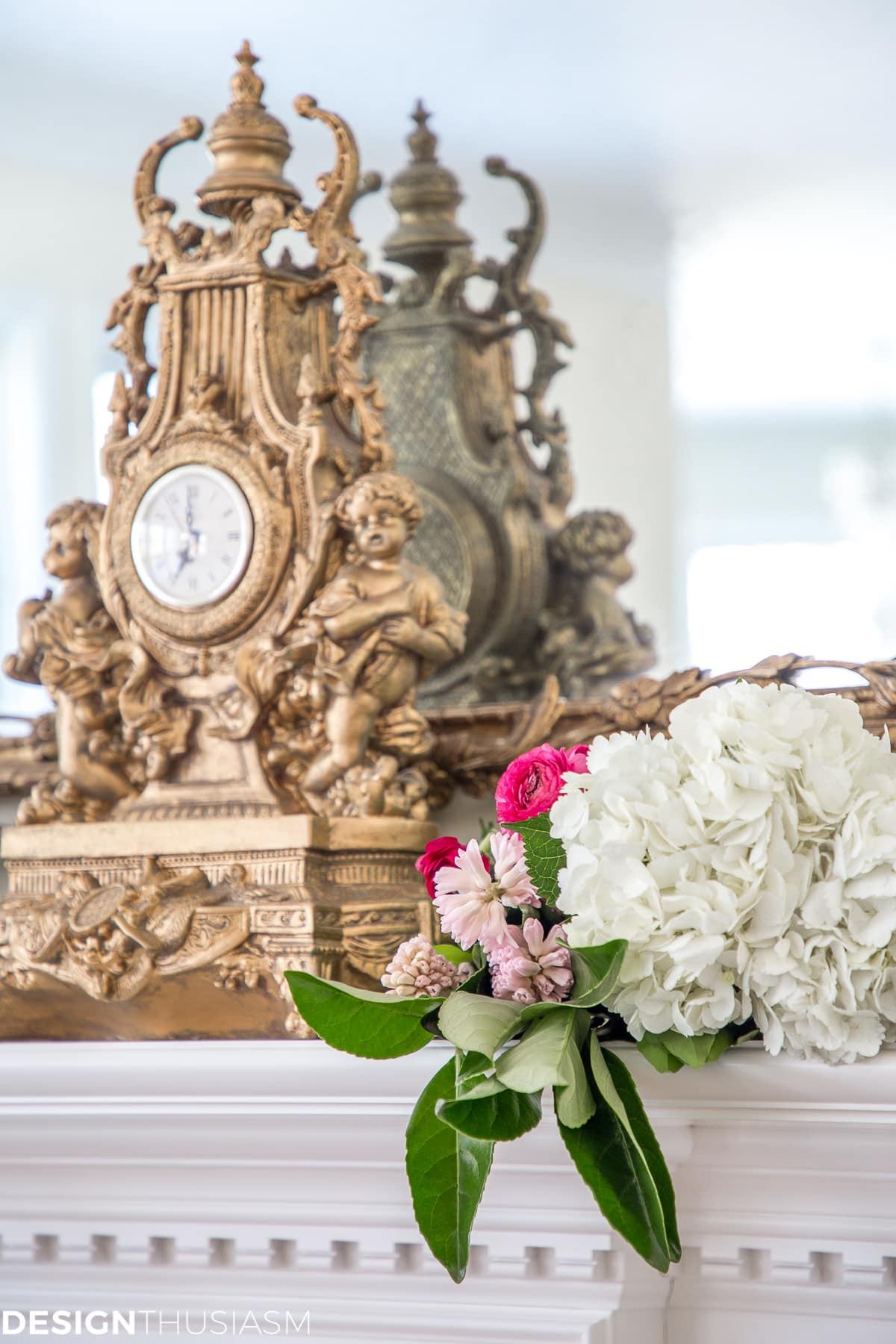 A French style chair accentuates a spring mantel - designthusiasm.com