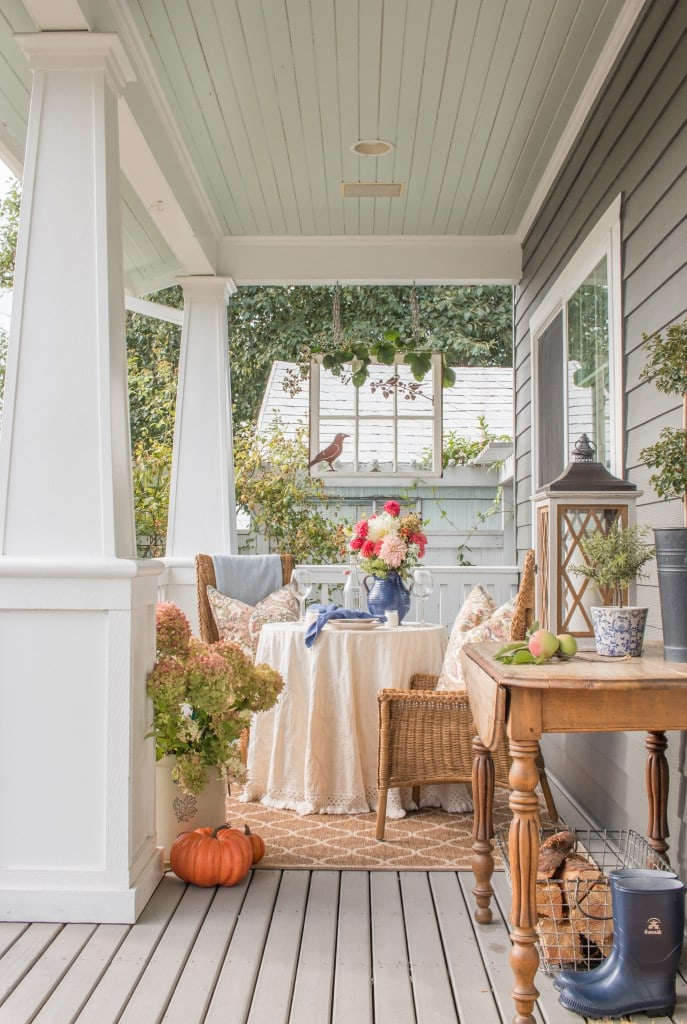 Fall-porch-bistro-table-with-orange-and-blue