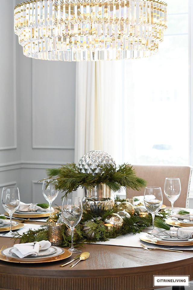 citrineliving-christmas-tablescape-with-fresh-greenery-metallic-ornaments-crystal-chandelier