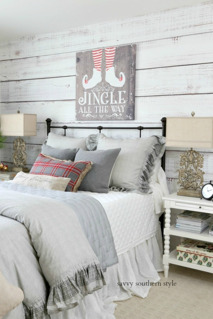 Christmas-decorated-bedroom-iron-bed-planked-wall