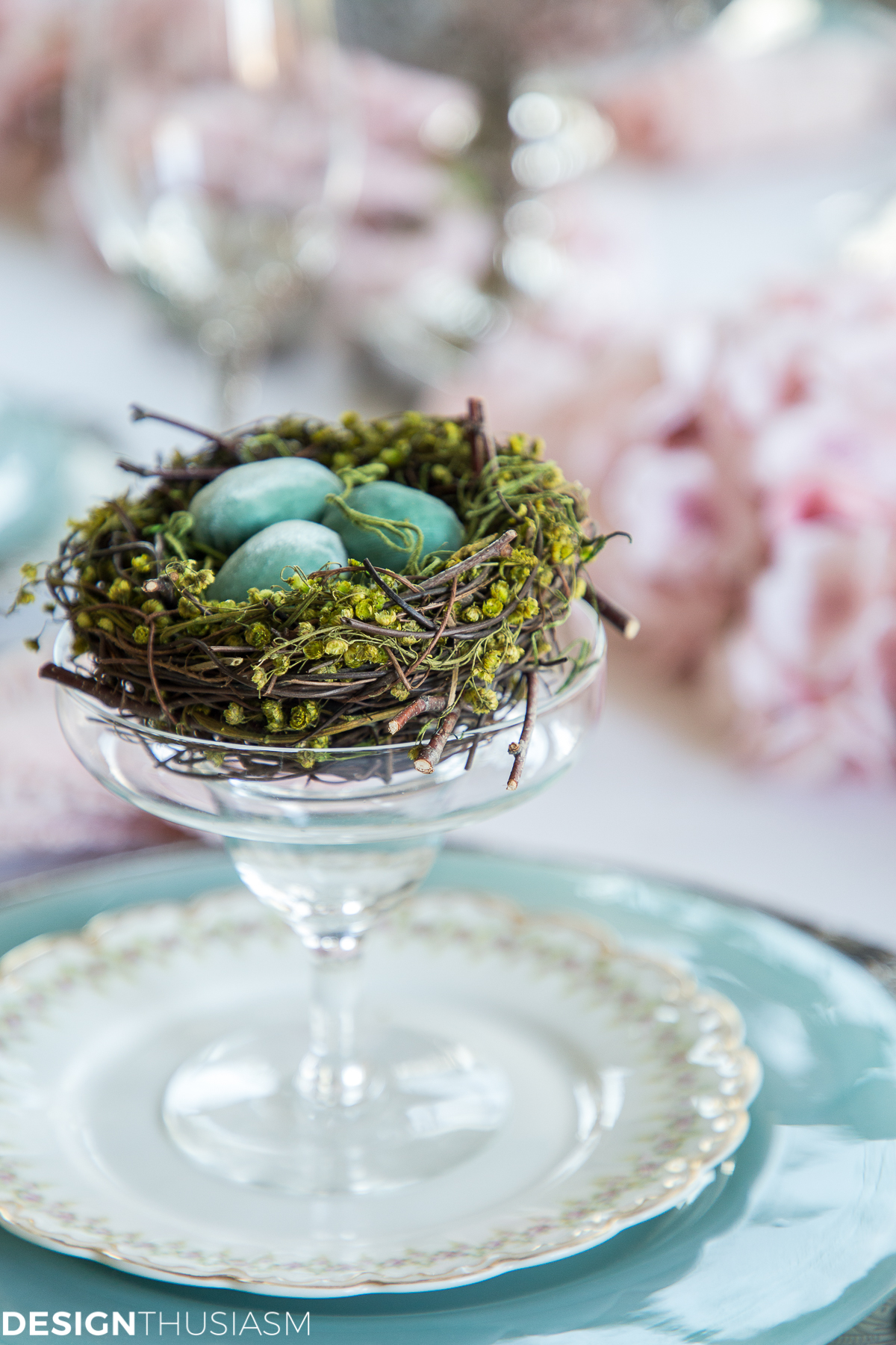 Easter table setting with bird nest and eggs in a fruit cup