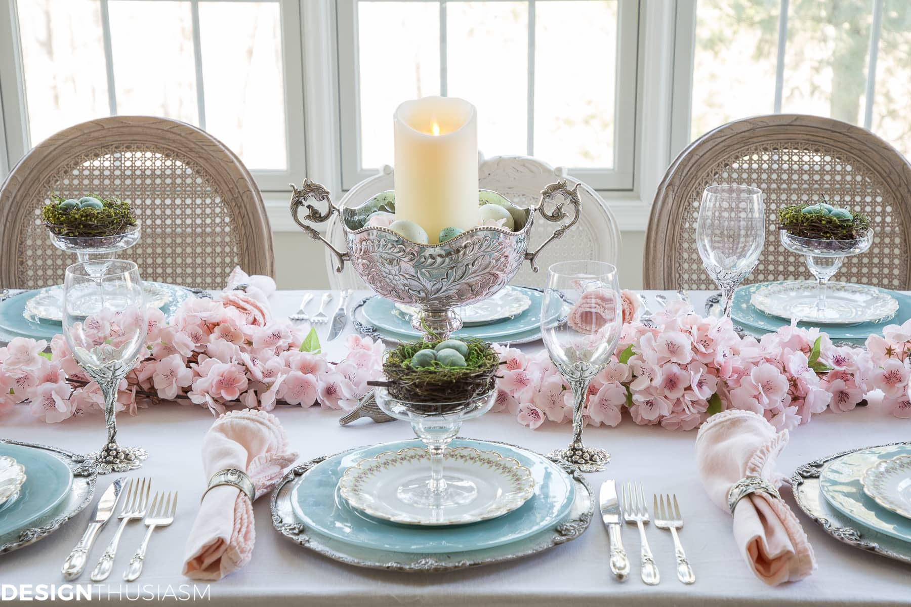 spring table setting with cherry blossom branch decorations
