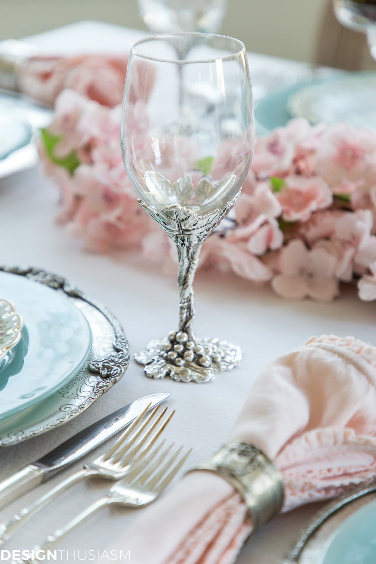 silver wine goblet in a cherry blossom branch tablescape