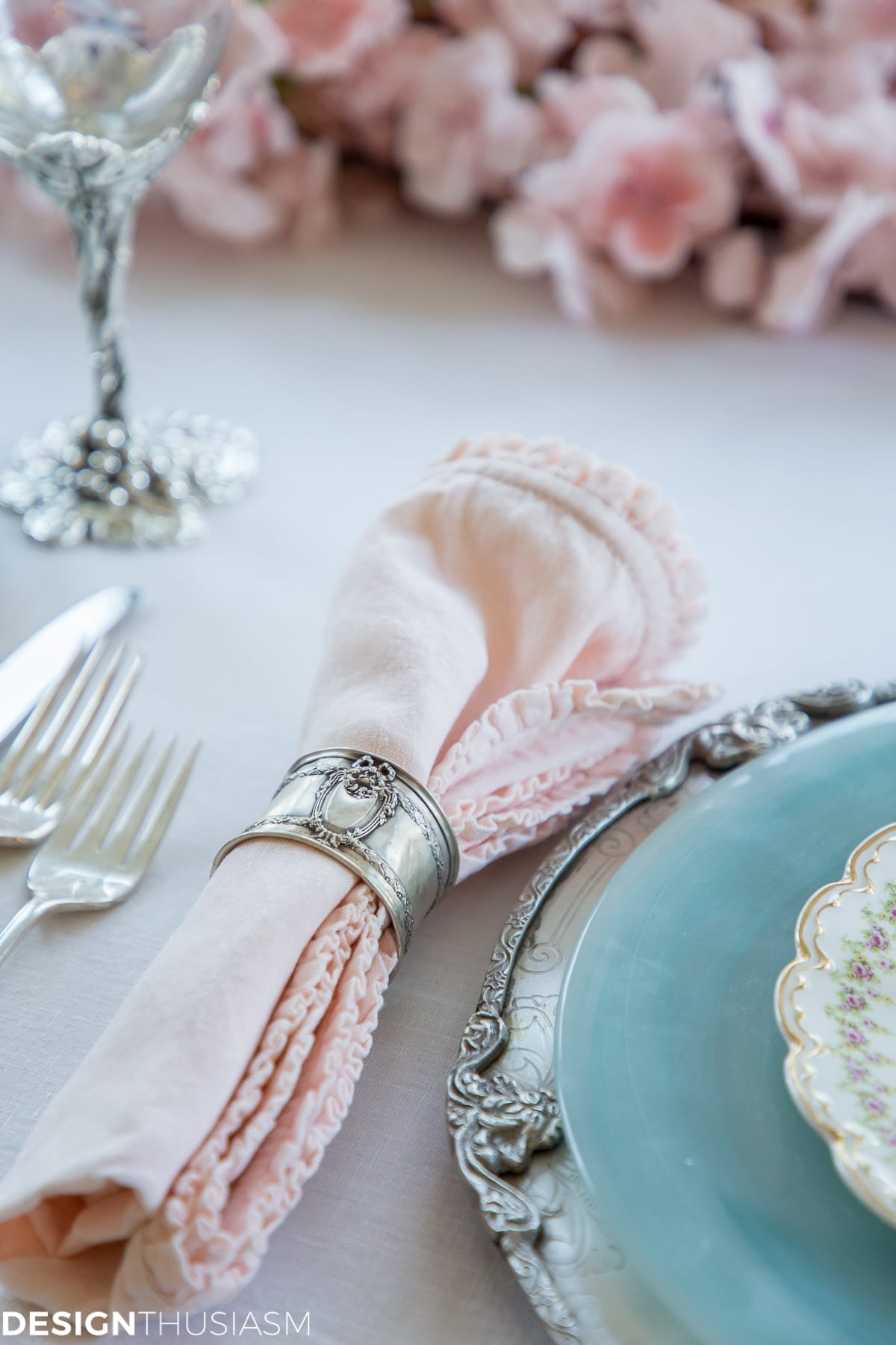 blush pink ruffled napkin and silver napkin ring