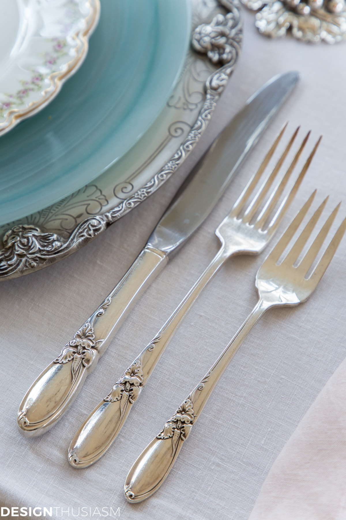 vintage silverware in a cherry blossom branch tablescape