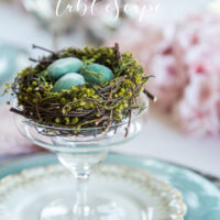 cherry blossom branch tablescape with nests