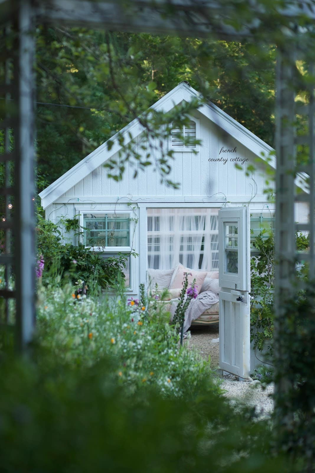 French Country Cottage She Shed through arbor