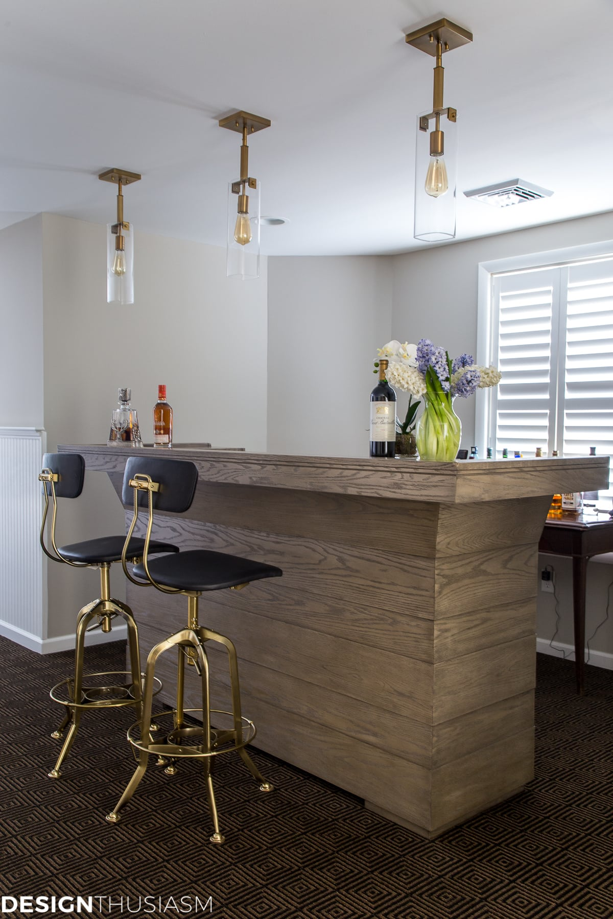 basement finishing bar with plantation shutters