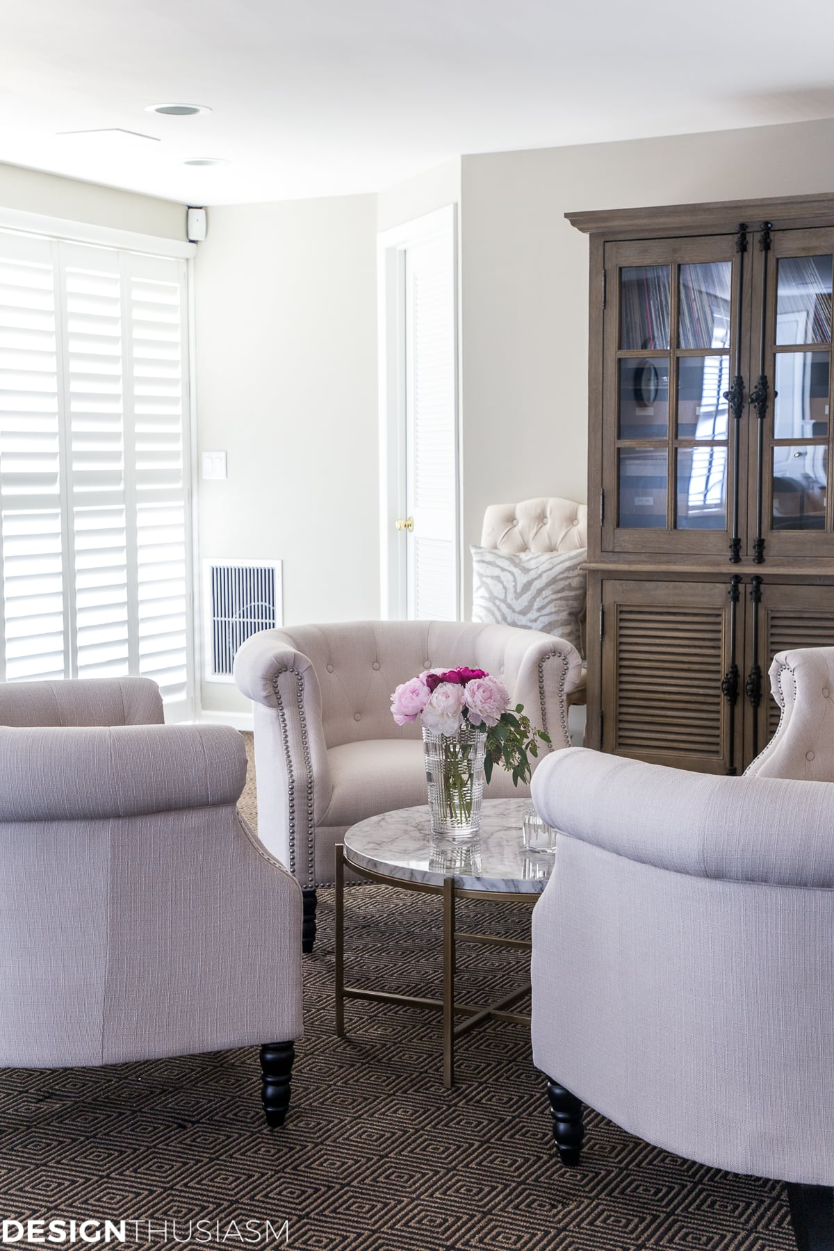 basement finishing white chairs and plantation shutters on sliding doors