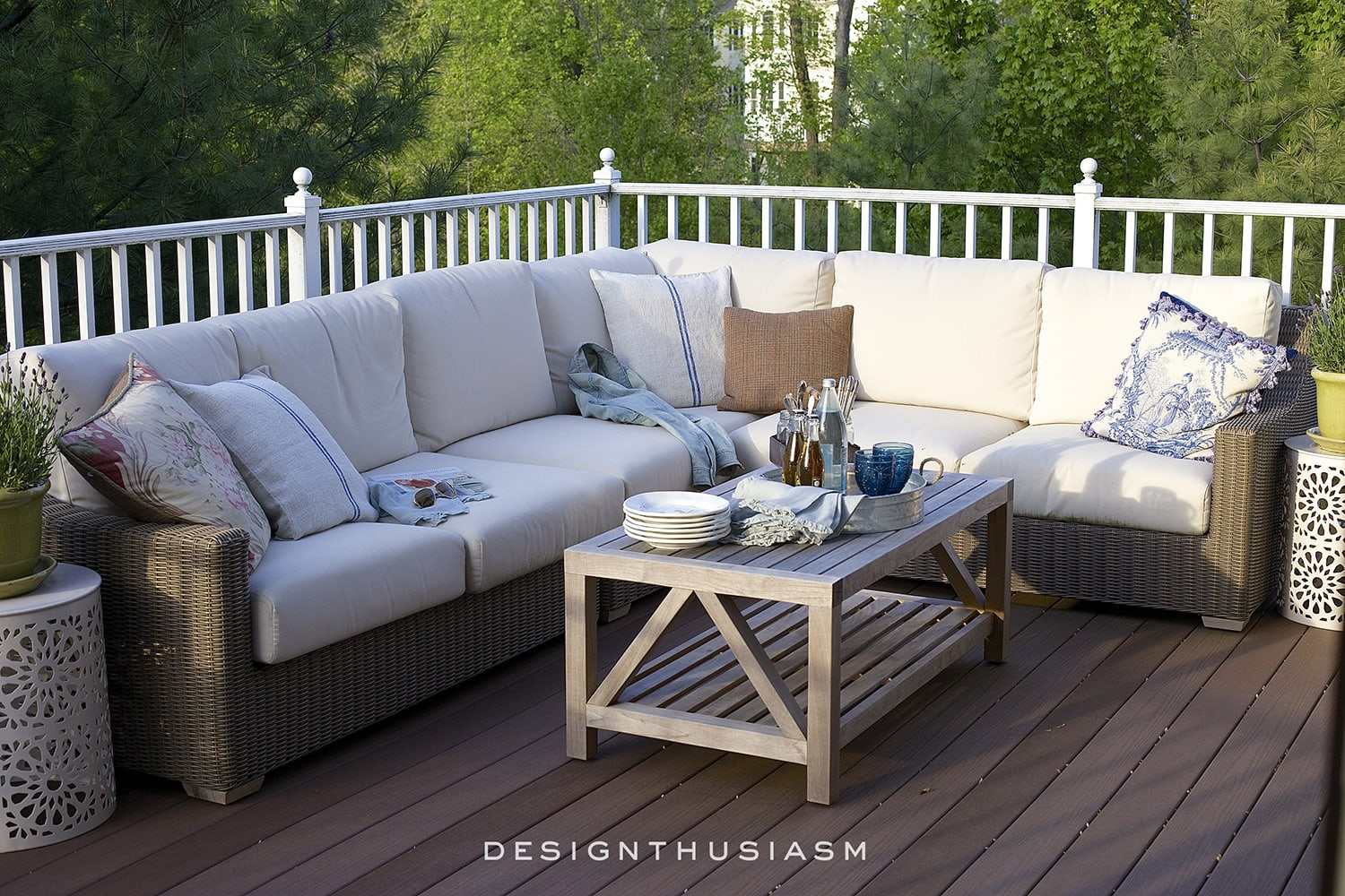 outdoor rooms white sectionals and teak coffee table